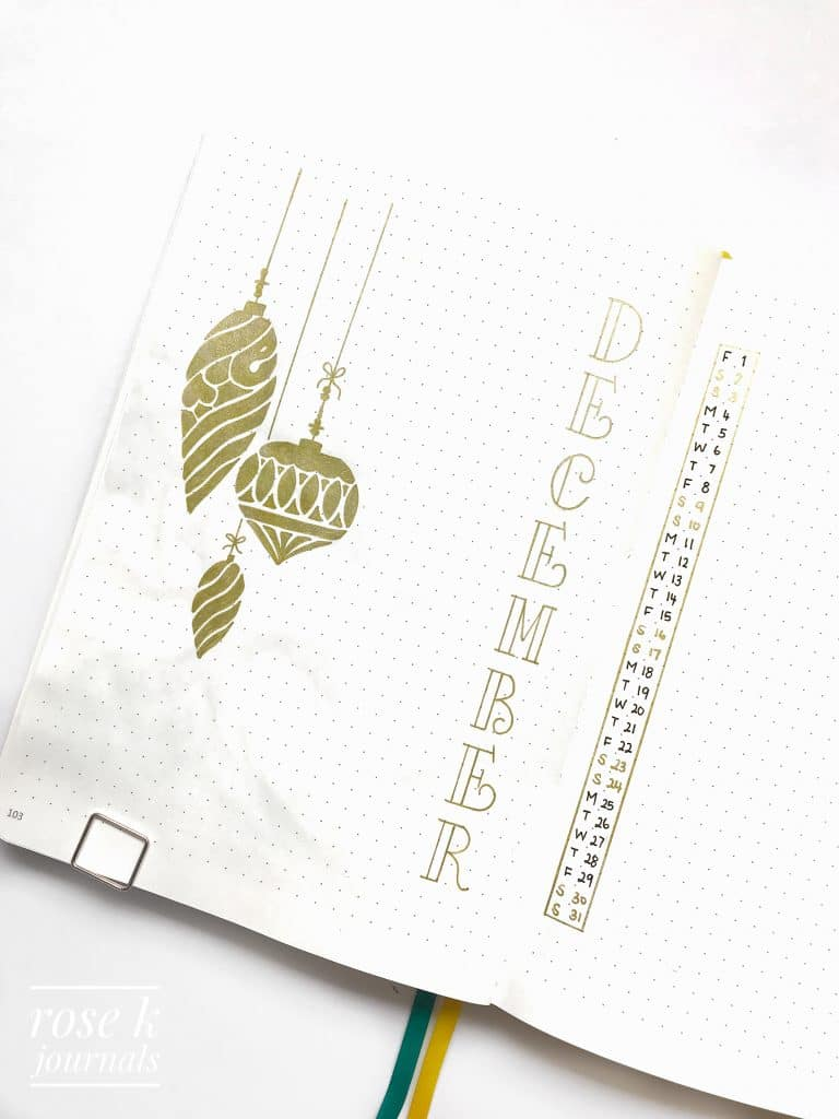 Rose K Journals bullet journal December Monthly log using gold pen to draw Christmas baubles
