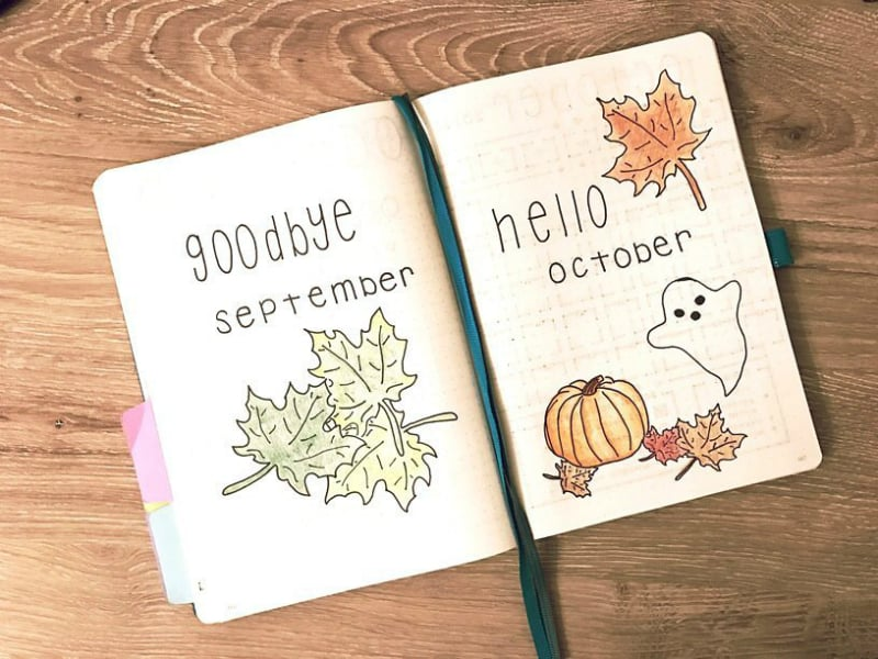 Halloween themed bullet journal spreads including monthly cover page by @bluenittany