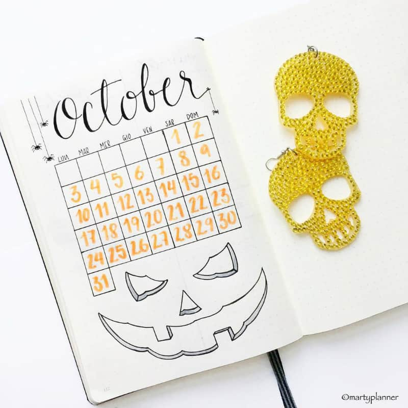 Bullet journal theme of Halloween for October monthly spread and monthly log by @martyplanner