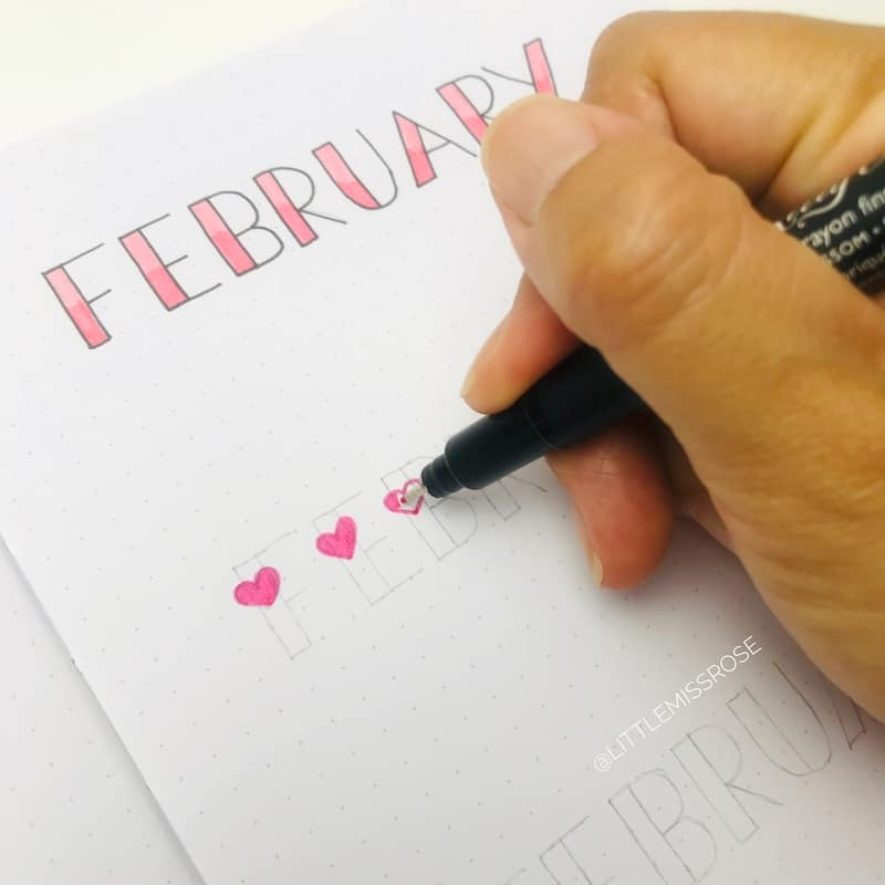 Romantic hand-lettering ideas for your bullet journal including this cute heart lettering.