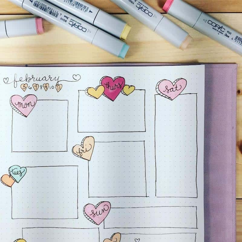 Check out these stunning Valentine's Day bullet journal spreads - weekly spread by @planalog